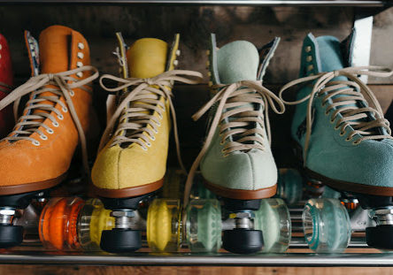 rollerskates in assorted colors on a shelf